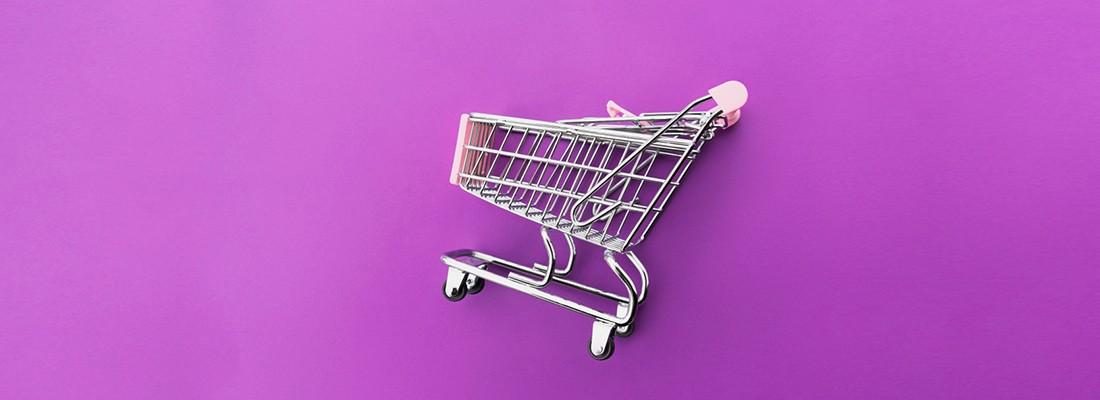 imagem de um carrinho de compras em um fundo roxo